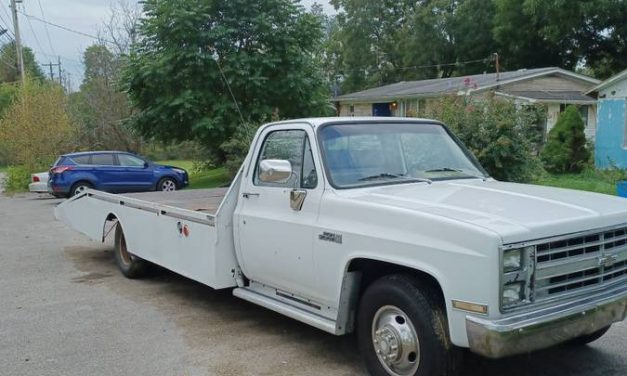 Car Carrier: 1983 GMC High Sierra 3500 Ramp Truck – $9,500